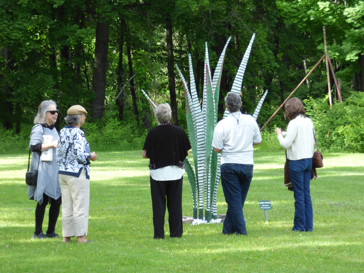 People enjoying art as members at Wilderstein Historic Site
