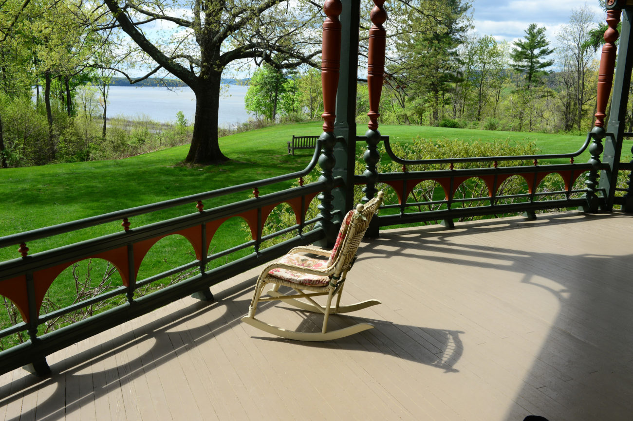 A rocking chair on the porch at Wilderstein Historic Site
